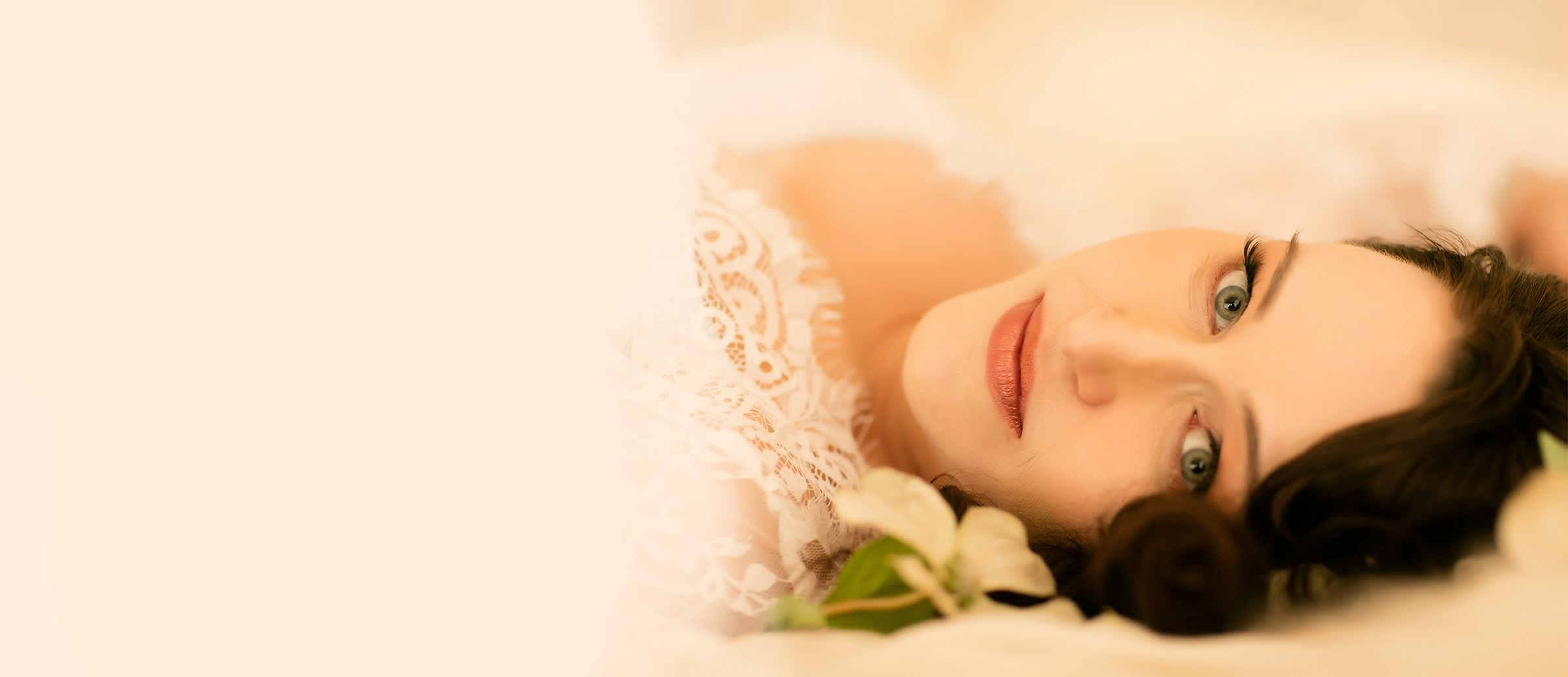 Boudoir Image of a womans face on the bed